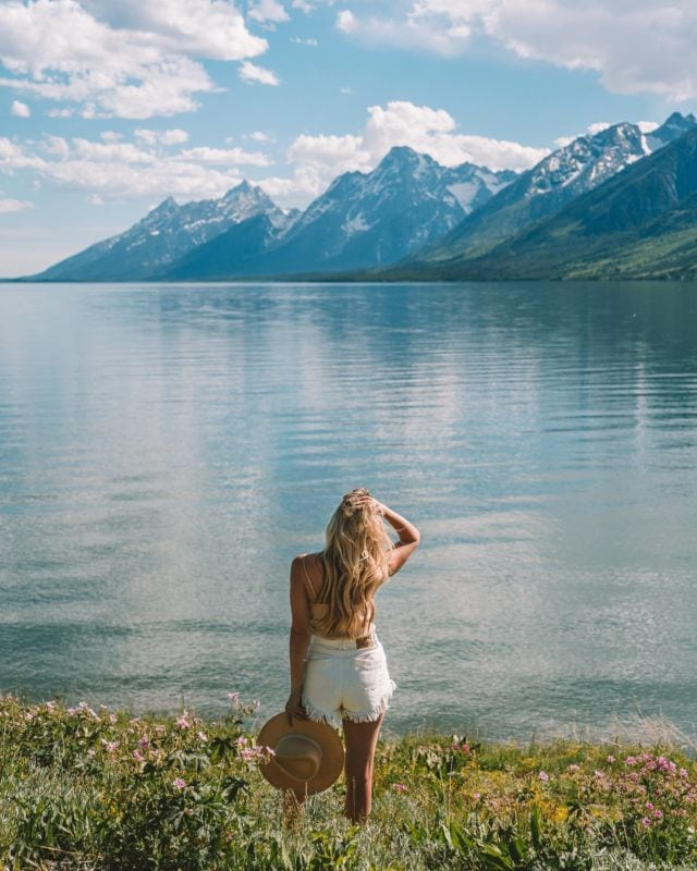 """Every time I see this photo it gives me Sound of Music """"hills are alive"""" vibes except replace hills with snow capped peaks and lakes and damn the Tetons are just stunning 🏔 🥰"""